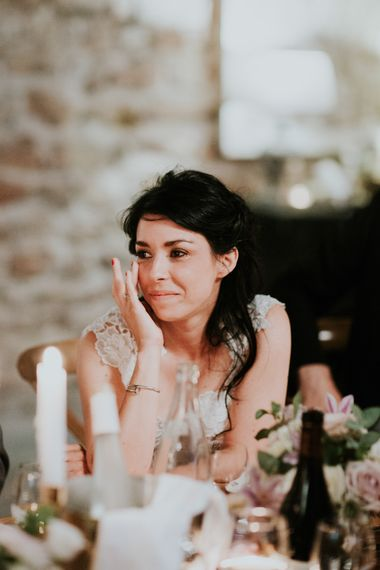 Beautiful Bride Wiping a Tear During Wedding Reception Speeches