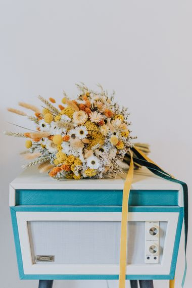 Yellow dried flower wedding bouquet for minimalist yellow wedding theme