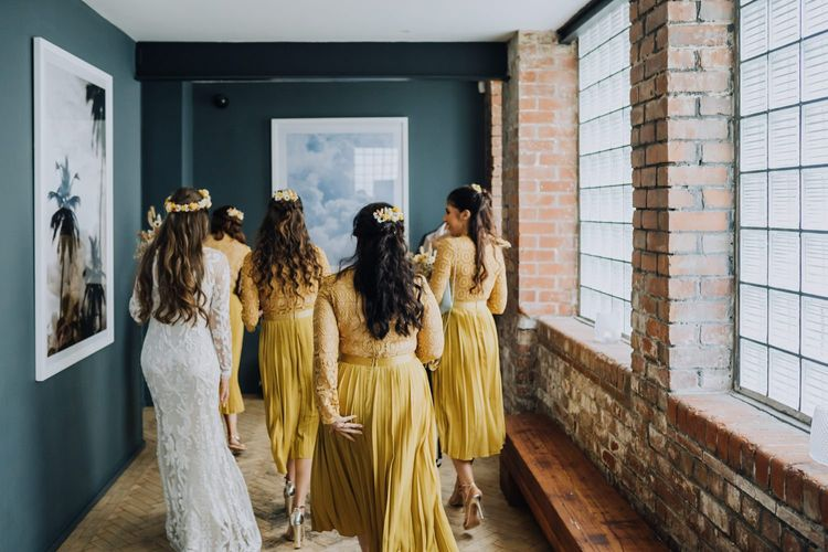 Bridesmaids in yellow dresses and bride in high street wedding dress