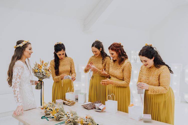 Bride giving her bridesmaids thank you gifts