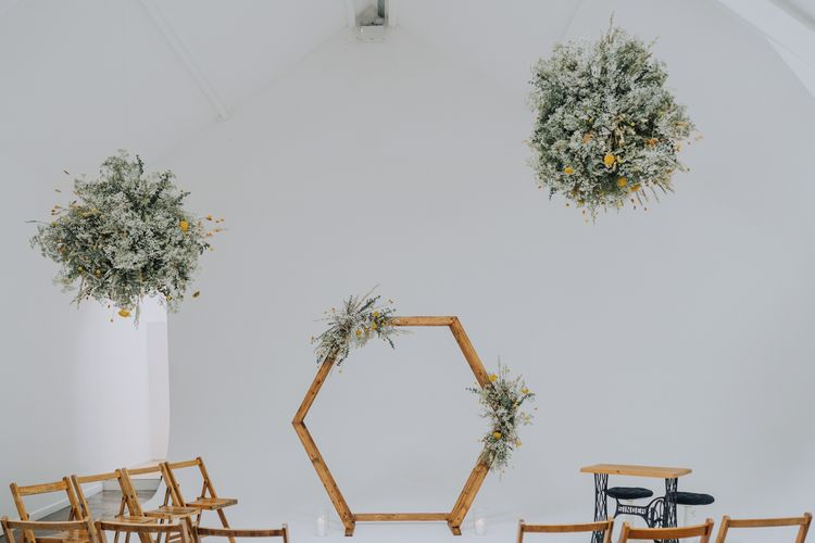 Minimalist wedding ceremony at FiveFourStudios with hexagonal wooden altar