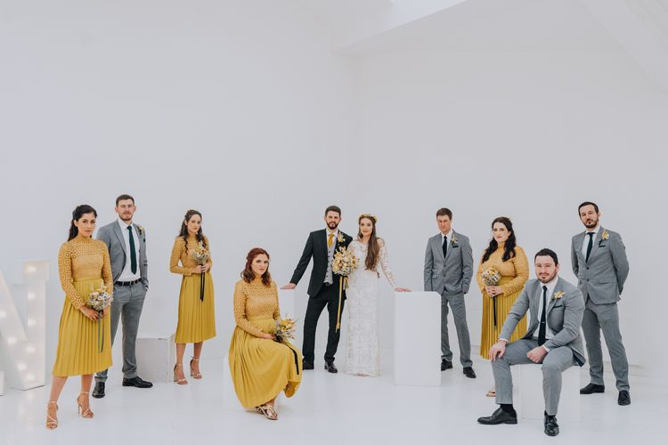 Wedding party portrait for minimalist yellow wedding theme