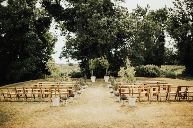 Outdoor Wedding Ceremony Set-up at Fishley Hall | Wedding Arch Sculpted from Trees | Aisle Lined with Potted Shrubbery and Trees | Outdoor Ceremony at Fishley Hall with Grace Loves Lace Fringe Dress | Darina Stoda Photography