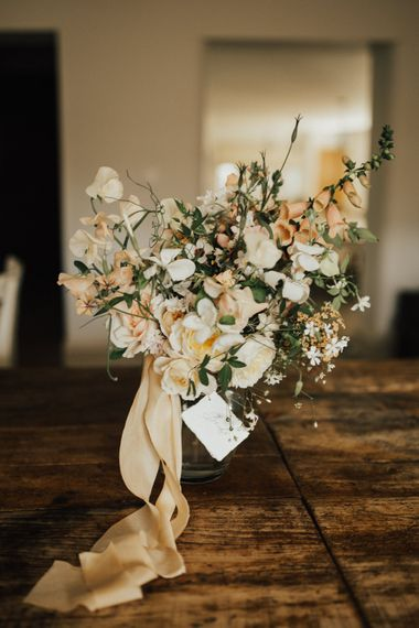Wedding Bouquet of Mixed Ochre and White Flowers with Champagne Trailing Ribbon | Outdoor Ceremony at Fishley Hall with Grace Loves Lace Fringe Dress | Darina Stoda Photography