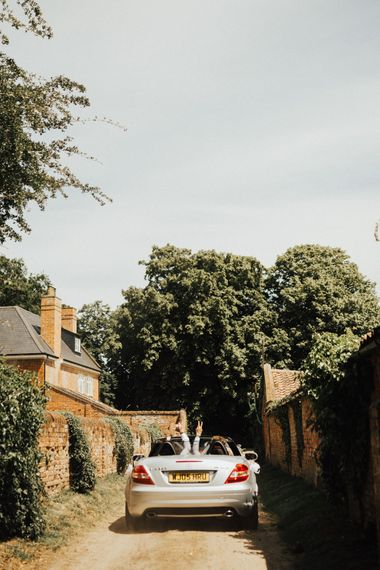 Groom Driving to Wedding Ceremony | Outdoor Ceremony at Fishley Hall with Grace Loves Lace Fringe Dress | Darina Stoda Photography
