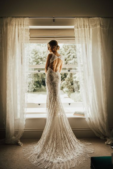 Bride in Embroidered Grace Loves Lace Gown with Fringing and Cut Out Back | Outdoor Ceremony at Fishley Hall with Grace Loves Lace Fringe Dress | Darina Stoda Photography