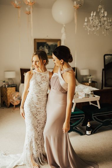 Bride in Embroidered Grace Loves Lace Gown with Fringing and Cut Out Back | Bridesmaid in Halterneck Dusty Pink TFNC Dress | Outdoor Ceremony at Fishley Hall with Grace Loves Lace Fringe Dress | Darina Stoda Photography