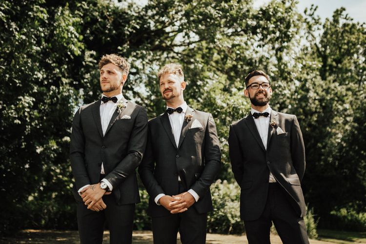 Groom Waiting For His Bride | Groom and Groomsmen in Black Gagliardi Suits with Bow Tie and Braces | Outdoor Ceremony at Fishley Hall with Grace Loves Lace Fringe Dress | Darina Stoda Photography
