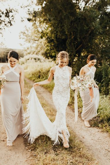 Bride in Embroidered Grace Loves Lace Gown with Fringing and Cut Out Back | Bridesmaids in Halterneck Dusty Pink TFNC Dresses | Bridal Bouquet of Mixed Flowers and Foliage with Champagne Trailing Ribbon | Bridesmaids Bouquets with Burnt Orange trailing Ribbons | Outdoor Ceremony at Fishley Hall with Grace Loves Lace Fringe Dress | Darina Stoda Photography