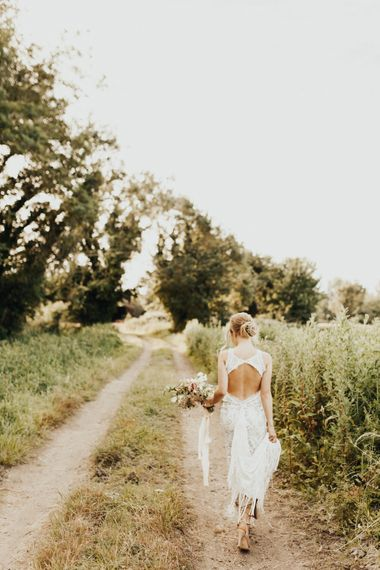 Bride in Embroidered Grace Loves Lace Gown with Fringing and Cut Out Back | Bridal Bouquet of Mixed Flowers and Foliage with Champagne Trailing Ribbon | Outdoor Ceremony at Fishley Hall with Grace Loves Lace Fringe Dress | Darina Stoda Photography