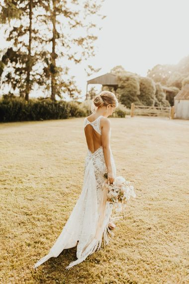 Bride in Embroidered Grace Loves Lace Gown with Fringing and Cut Out Back | Nude Strappy Nine West Shoes | Bridal Bouquet of Mixed Flowers and Foliage with Champagne Trailing Ribbon | Outdoor Ceremony at Fishley Hall with Grace Loves Lace Fringe Dress | Darina Stoda Photography