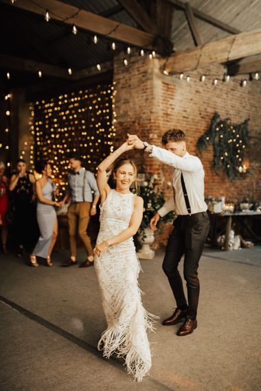 First Dance | Bride in Embroidered Grace Loves Lace Gown with Fringing and Cut Out Back | Groom in Black Gagliardi Suit with Bow Tie and Braces | Fairylight Canopy | Festoon Lights | Outdoor Ceremony at Fishley Hall with Grace Loves Lace Fringe Dress | Darina Stoda Photography