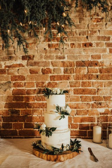 Three Tier Semi-Naked Wedding Cake Presented on Log Slice | Pillar Candles | Outdoor Ceremony at Fishley Hall with Grace Loves Lace Fringe Dress | Darina Stoda Photography