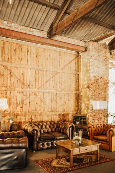 Chill Out Area with Leather Sofas and Fairylight Canopy | Outdoor Ceremony at Fishley Hall with Grace Loves Lace Fringe Dress | Darina Stoda Photography
