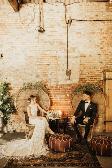Peacock Chairs Decorated with Foliage | Bride in Embroidered Grace Loves Lace Gown with Fringing and Cut Out Back | Groom in Black Gagliardi Suit with Bow Tie and Braces | Outdoor Ceremony at Fishley Hall with Grace Loves Lace Fringe Dress | Darina Stoda Photography