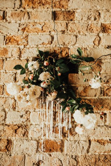 Floral Wall Decoration with Dripping Wax | Outdoor Ceremony at Fishley Hall with Grace Loves Lace Fringe Dress | Darina Stoda Photography