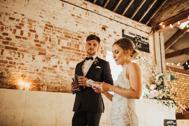 Bride and Groom Speech | Bride in Embroidered Grace Loves Lace Gown with Fringing and Cut Out Back | Groom in Black Gagliardi Suit with Bow Tie and Braces | Outdoor Ceremony at Fishley Hall with Grace Loves Lace Fringe Dress | Darina Stoda Photography