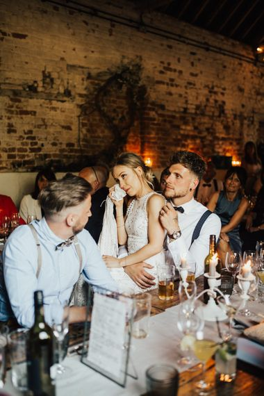 Bride Wiping Tears | Bride in Embroidered Grace Loves Lace Gown with Fringing and Cut Out Back | Groom in Black Gagliardi Suit with Bow Tie and Braces | Outdoor Ceremony at Fishley Hall with Grace Loves Lace Fringe Dress | Darina Stoda Photography
