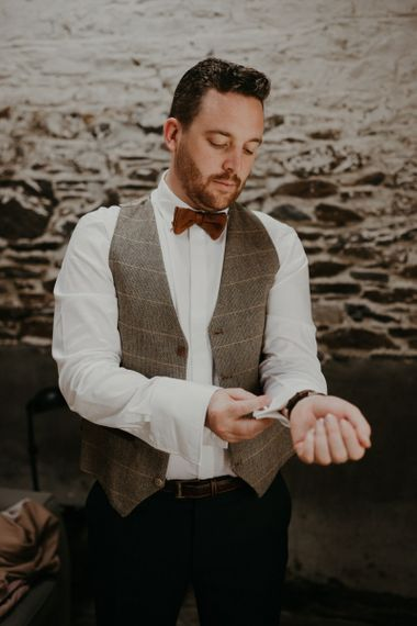 Groom preparations for glass house wedding with beaded bridesmaid dresses