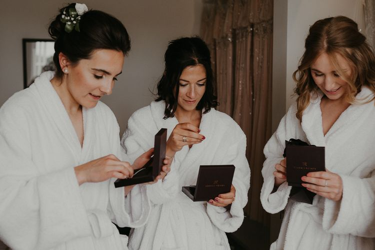 Bridesmaid opening gifts with  beaded bridesmaid dresses