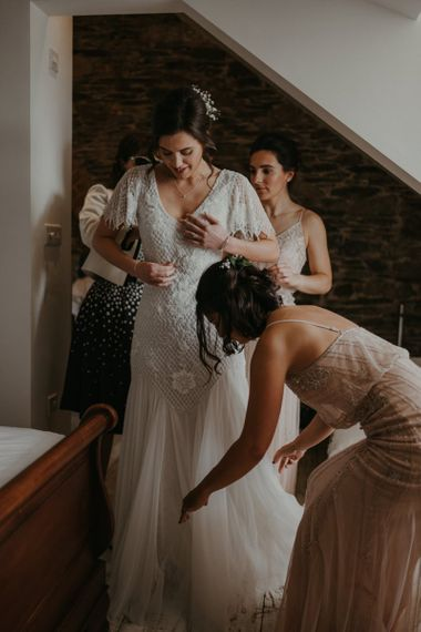 Bridal party preparations with beaded bridesmaid dresses