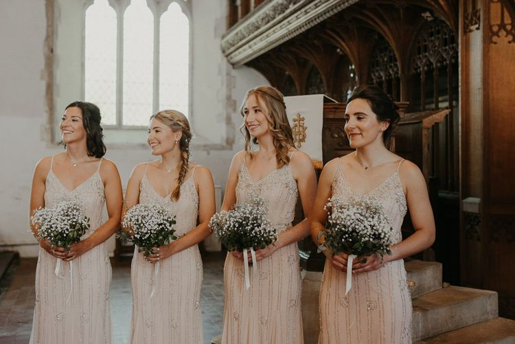 Beaded bridesmaid dresses with Gypsophila bouquets