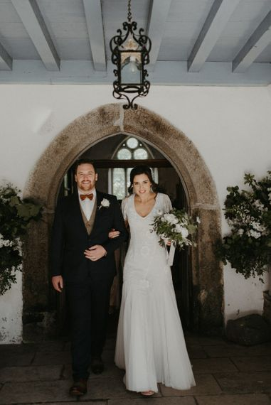 Bride and groom exit the church