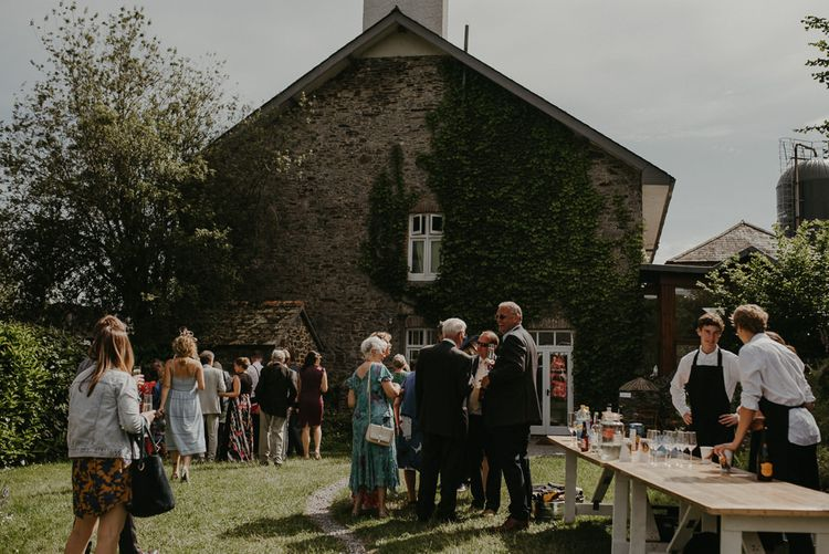 Guests enjoy drinks on the lawn