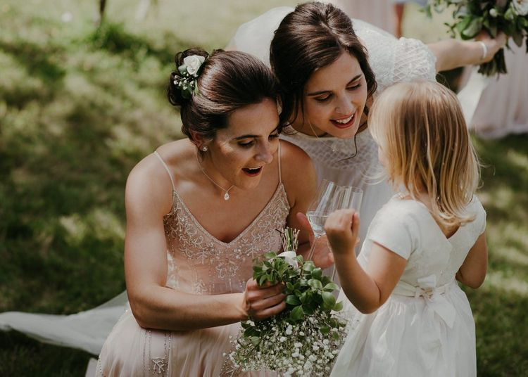 Bridesmaid in beaded bridesmaid dresses and flower girl with bride