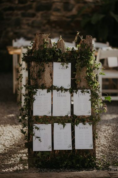 Wooden wedding sign with foliage decor