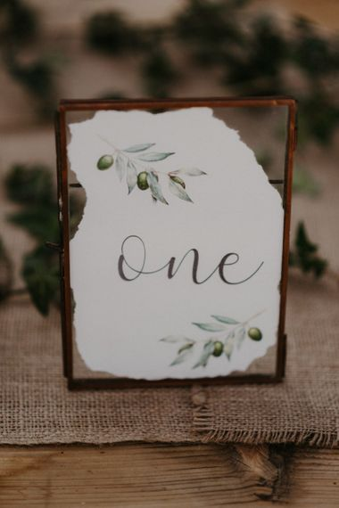 Rustic table numbers with olive branch decor