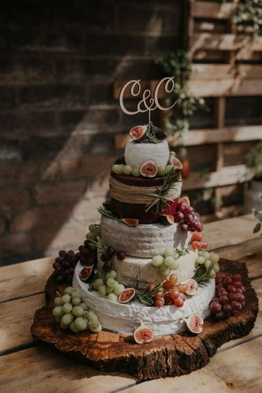 Cheese tower wedding cake at celebration with beaded bridesmaid dresses