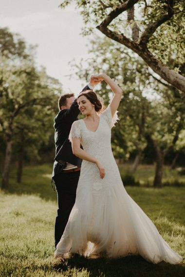 Bride in Eliza Jane Howell wedding dress with undo and hairpiece