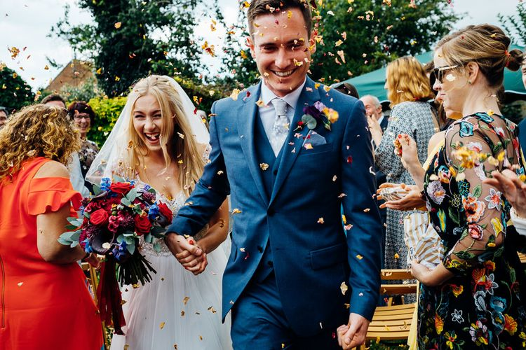 Confetti Exit | Bride in Beaded Bodice Gown | Groom in Blue Reiss Suit | Bright DIY 'At Home' Outdoor Garden Ceremony & Marquee Reception | Marianne Chua Photography