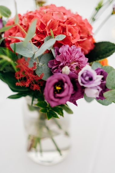 Colourful Flower Stems in Jars | Bright DIY 'At Home' Outdoor Garden Ceremony & Marquee Reception | Marianne Chua Photography