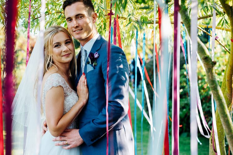Ribbon Decor | Bride in Beaded Bodice Gown | Groom in Blue Reiss Suit | Bright DIY 'At Home' Outdoor Garden Ceremony & Marquee Reception | Marianne Chua Photography