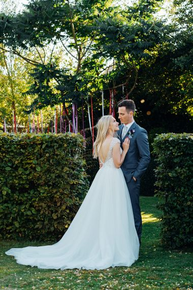 Bride in Beaded Bodice Gown | Groom in Blue Reiss Suit | Bright DIY 'At Home' Outdoor Garden Ceremony & Marquee Reception | Marianne Chua Photography