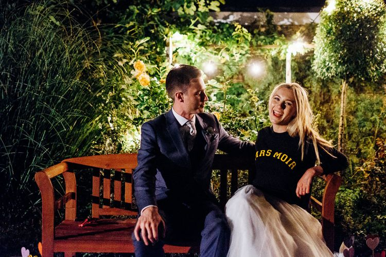 Bride in Personalised Jumper | Groom in Blue Reiss Suit | Bright DIY 'At Home' Outdoor Garden Ceremony & Marquee Reception | Marianne Chua Photography