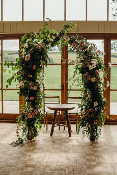 Flower arch with wildflowers and foliage
