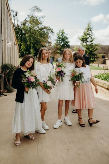 Young Bridesmaids in White and Blush Dresses