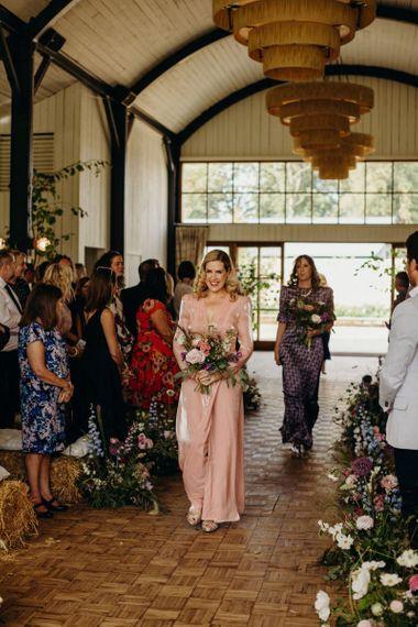 Bridesmaid in Blush Pink Dress Walking Down the Aisle