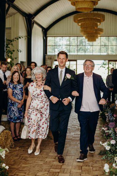 Groom Entrance with His Parents at Soho Farmhouse Wedding Ceremony
