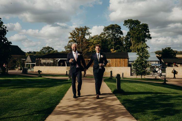Same Sex Couple Holding Hands Outside Their Soho Farmhouse Wedding Venue