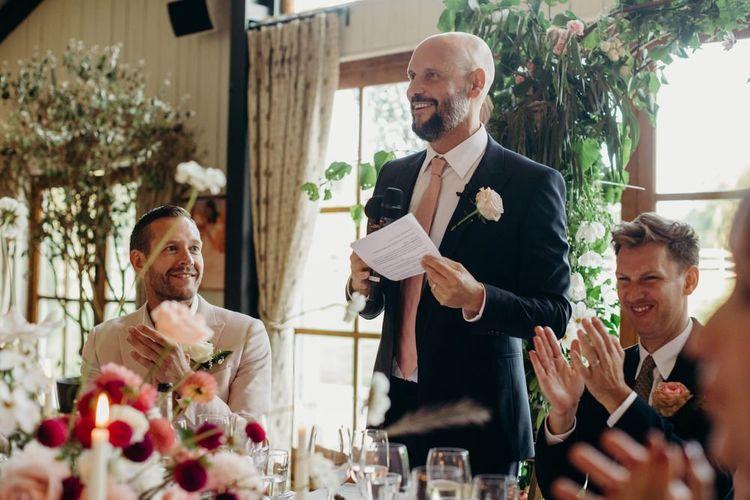 Groom in Navy Suit Reading His Wedding Speech