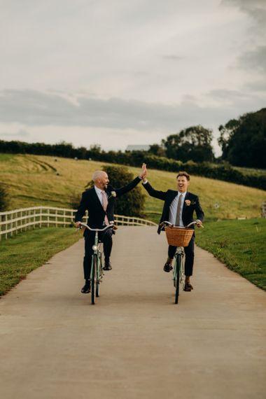 Same Sex Couple Portrait on Bicycles at Soho Farmhouse Wedding