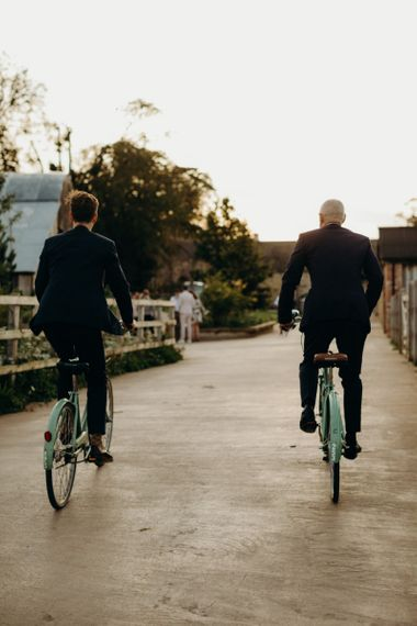 Grooms Cycling at Soho Farmhouse wedding