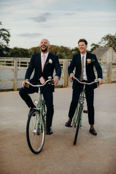 Two Grooms in Vintage Bicycles