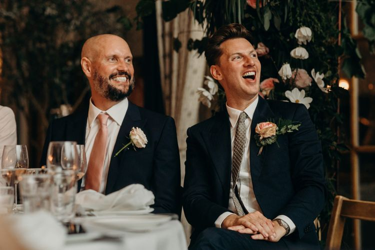Grooms Laughing During the Speeches