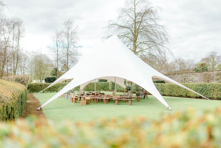 Ceremony on The Lawn with Benches and Stretch Tent Canopy