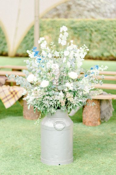 Milk Churn Filled with Blue and white Wedding Flowers